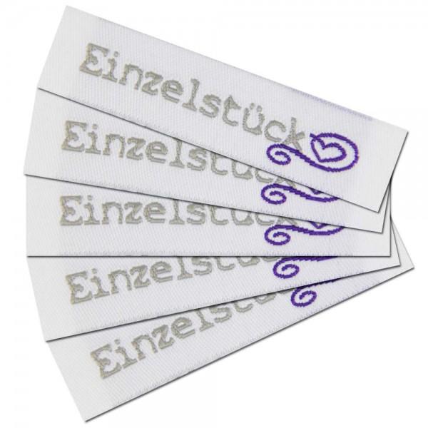 "Étiquette textile ""Einzelstück"""